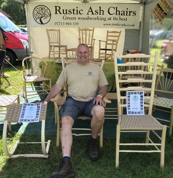 Mark Griffin Sitting With Two Of His Winning Rustic Ash Chairs And Certificates At Bodgers Ball 2018