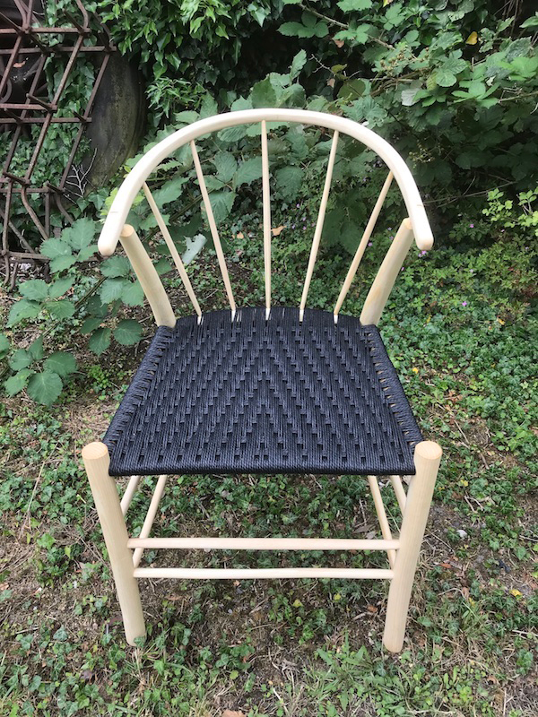 Front view of a 5 spindle back Swoop chair with black danish cord seat