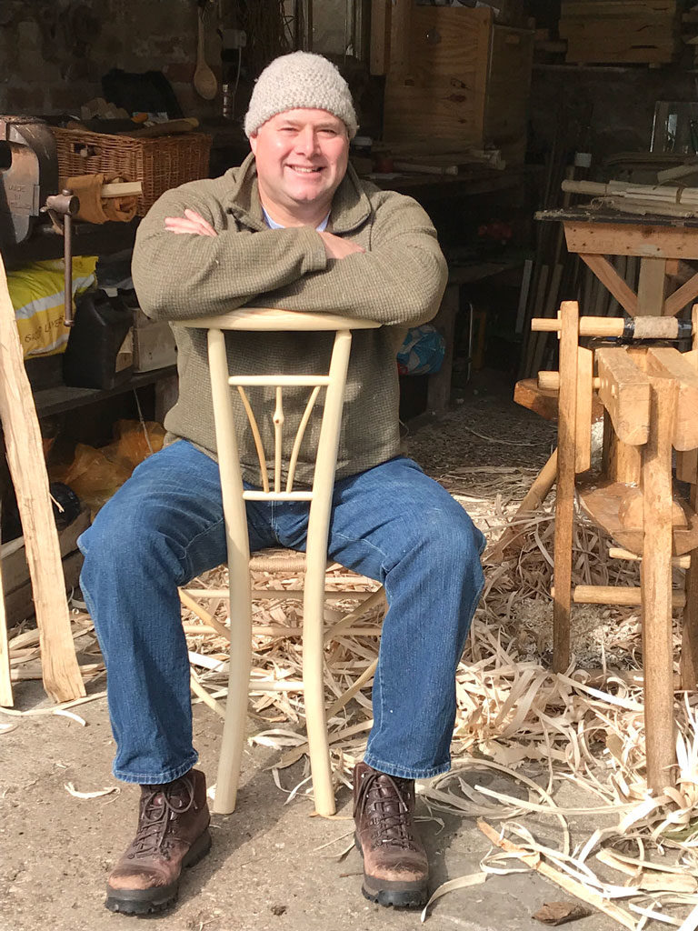 Mark Griffin Of Rustic Ash Chairs Sitting On One Of His Triangular Shaped Gentlemans Chairs