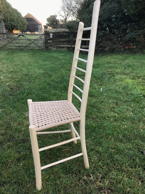 side view of asymmetrical ladder back side chair by rustic ash chairs