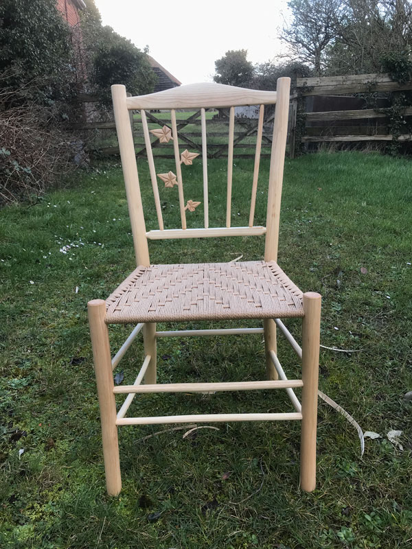 Traditional spindle back side chair with ivy leaves on a spindle