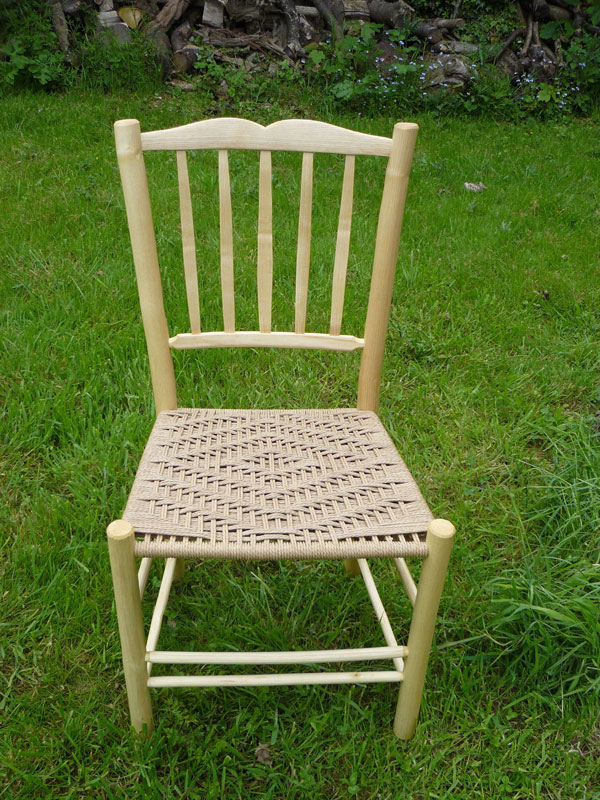 lath back side chair with a sweetheart crest and danish cord seat