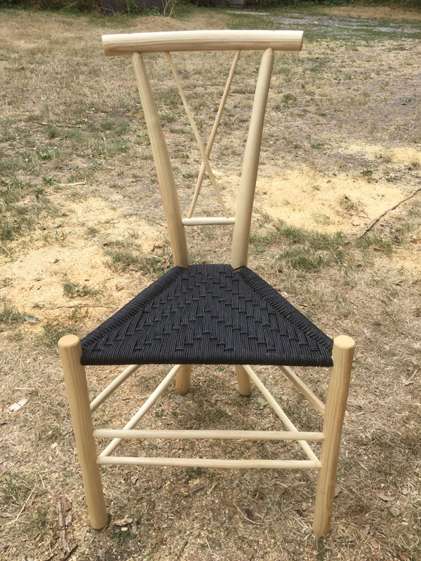 A Gentleman's Chair with a cross-shaped spindle back and black seat