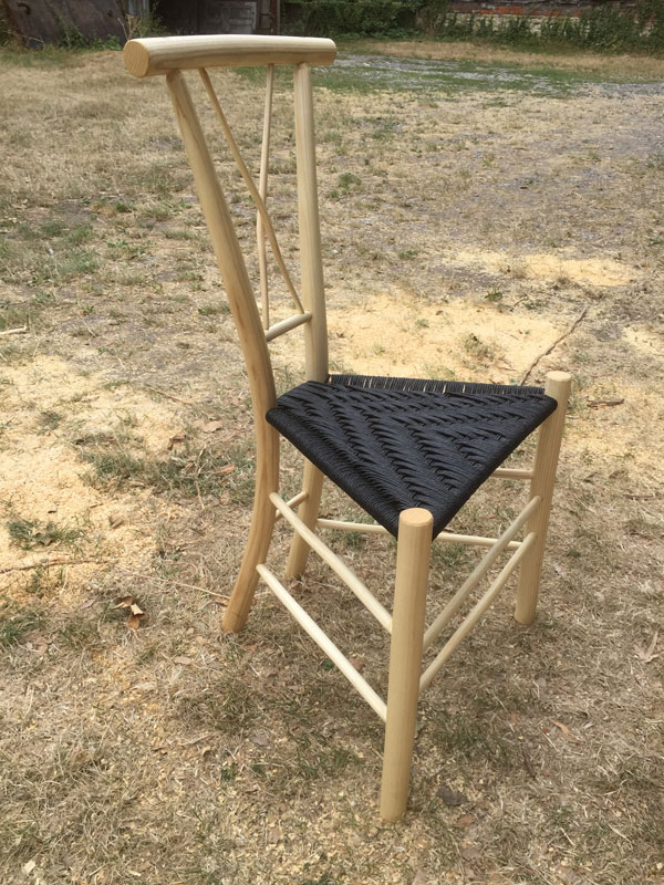 Gentleman's Chair with a cross-shaped spindle back and black seat - side view