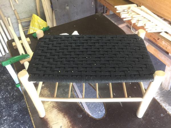 double sized footstool with magazine under side and black top