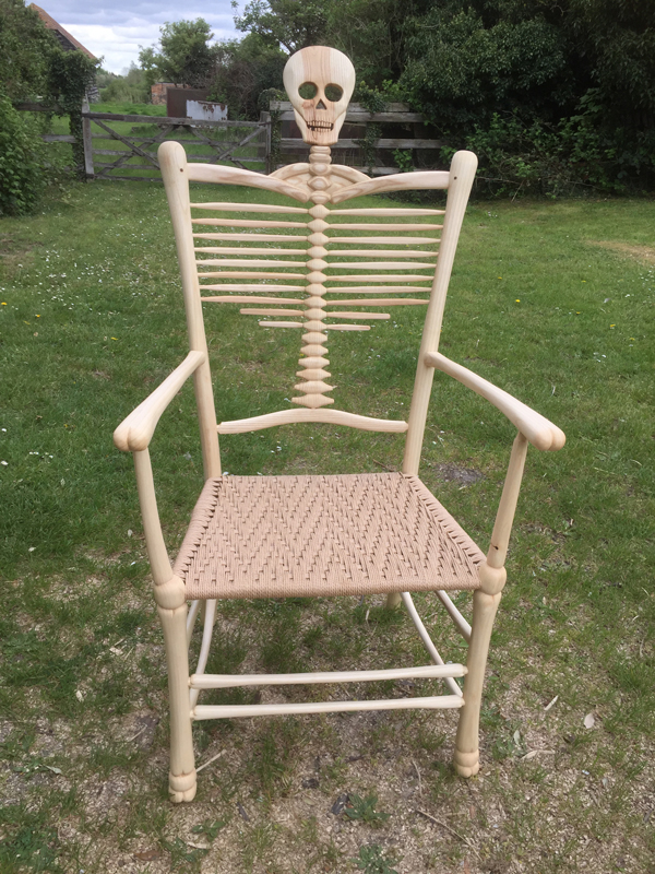 Rustic Ash Chairs' Award Winning hand-carved Skeleton Chair with skull and bones features