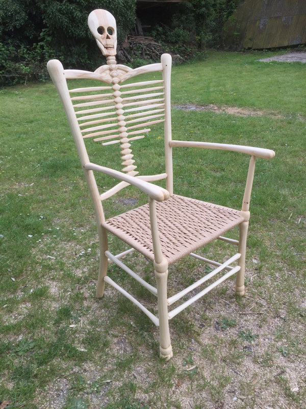 Side View 1, Rustic Ash Chairs' Award Winning Skeleton Chair with skull and bones features