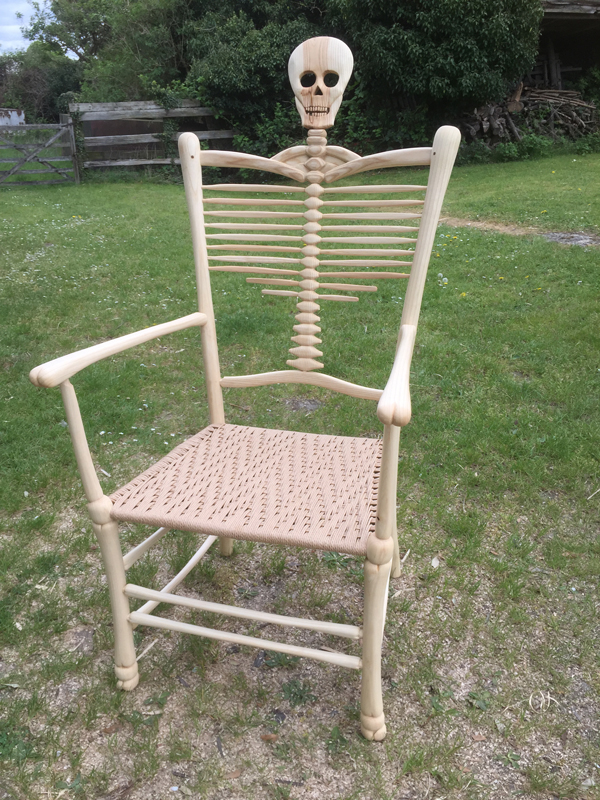 Side View 2, Rustic Ash Chairs' Award Winning Skeleton Chair with skull and bones features