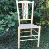 Negative leaf lath back dining chair with danish cord seat