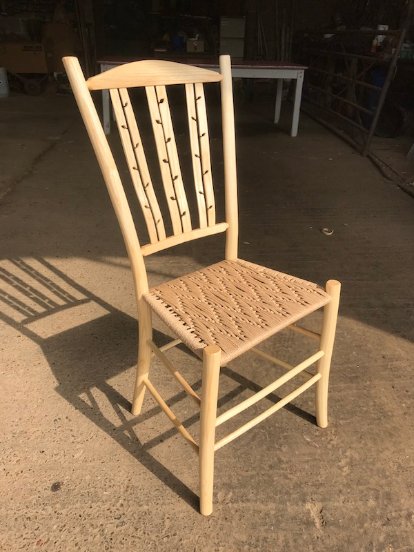 Multi-Negative leaf shaped lath back dining chair with danish cord seat