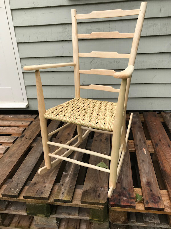 ladderback rocking chair with five ladders and a paper rush fibre cord seat - front view
