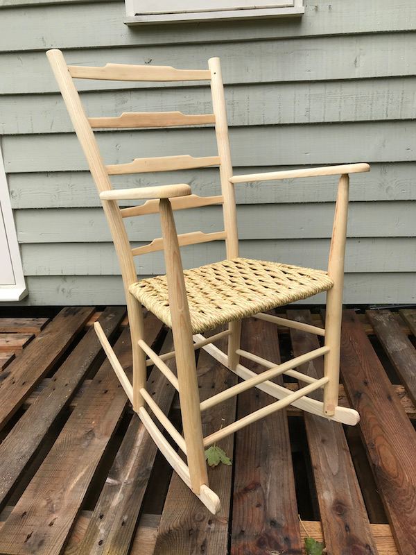 ladderback rocking chair with five ladders and a paper rush fibre cord seat