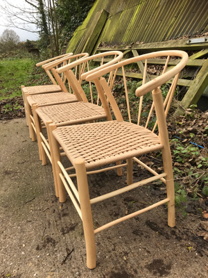 side view of a row of Swoop dining chairs