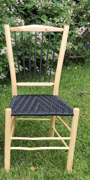 Harlequin Natural spindle back side chair with black ash wood spindles and seat