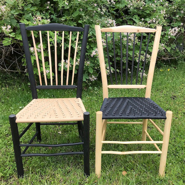 A pair of Harlequin Black and Harlequin Natural spindle back side chairs