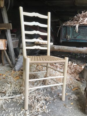A Rustic Ash Chairs Sweetheart Ladderback Dining Chair with Danish cord seat weave