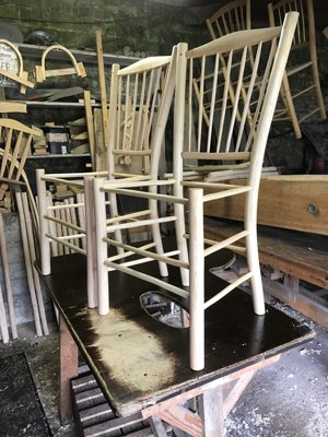 2 spindle-back side chair frames on the workbench