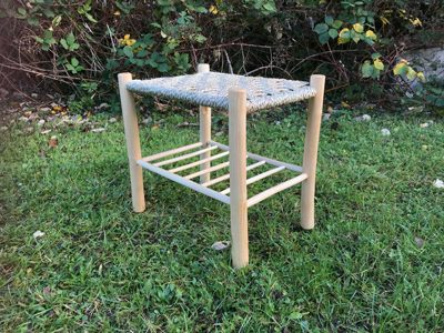 a rustic ash chairs stool with an under rack and kambaa woven seat