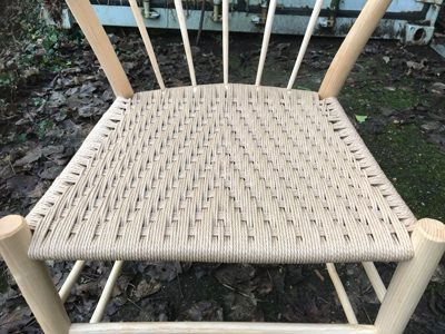 Seats are woven using natural Danish cord in a modified Irish weave pattern.