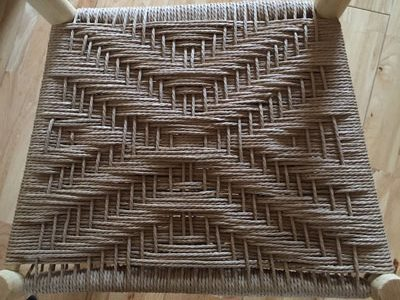 Traditional Danish Cord Twill Weaving Pattern On A Rustic Ash Chair Seat